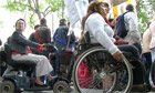 disabled protesters marching