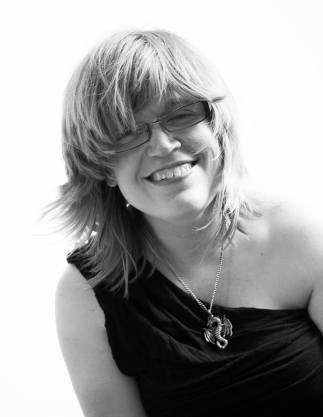 Black and white photo of the author, Melissa Graham